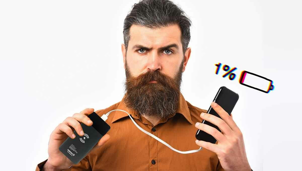 bearded man with wireless power bank charger